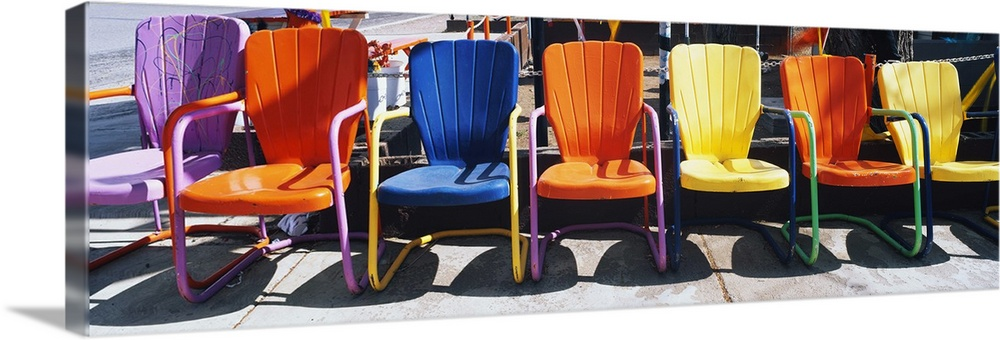Large Solid-Faced Canvas Print Wall Art Print 48 x 16 entitled Chairs Solid-Faced Canvas Print entitled Chairs.  Multiple sizes available.  Primary colors within this image include Orange, Dark Red, White, Dark Navy Blue.  Made in USA.  All products come with a 365 day workmanship guarantee.  Archival-quality UV-resistant inks.  Canvas is handcrafted and made-to-order in the United States using high quality artist-grade canvas.  Archival inks prevent fading and preserve as much fine detail as possible with no over-saturation or color shifting.
