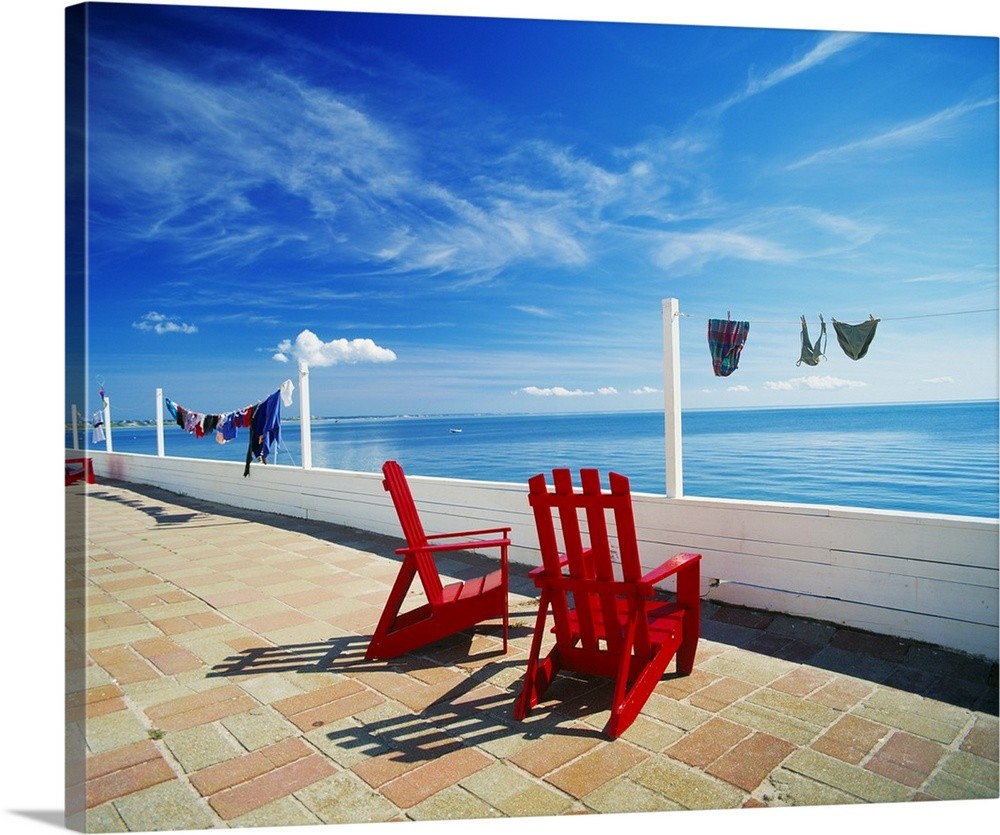 Large Solid-Faced Canvas Print Wall Art Print 30 x 24 entitled Chairs Cape Cod MA Solid-Faced Canvas Print entitled Chairs Cape Cod MA.  Multiple sizes available.  Primary colors within this image include Dark Red, Dark Blue, Black, Royal Blue.  Made in USA.  All products come with a 365 day workmanship guarantee.  Inks used are latex-based and designed to last.  Canvas depth is 1.25 and includes a finished backing with pre-installed hanging hardware.  Canvas is handcrafted and made-to-order in the United States using high quality artist-grade canvas.