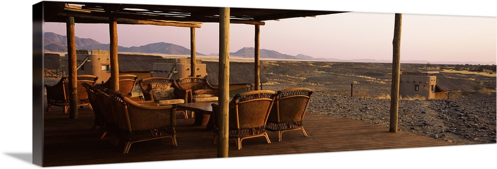 Large Solid-Faced Canvas Print Wall Art Print 48 x 16 entitled Chairs on a veranda Kulala Wilderness Reserve Sossusvlei Na... Solid-Faced Canvas Print entitled Chairs on a veranda Kulala Wilderness Reserve Sossusvlei Namib Desert Namibia.  Multiple sizes available.  Primary colors within this image include Brown, Dark Gray, Gray, White.  Made in USA.  Satisfaction guaranteed.  Inks used are latex-based and designed to last.  Featuring a proprietary design, our canvases produce the tightest corners without any bubbles, ripples, or bumps and will not warp or sag over time.  Canvas is handcrafted and made-to-order in the United States using high quality artist-grade canvas.