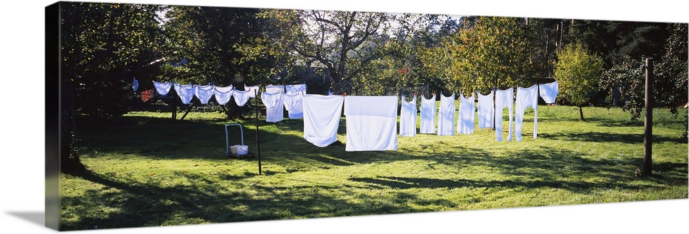 Large Gallery-Wrapped Canvas Wall Art Print 30 x 10 entitled Clothes drying on a clothesline in a backyard, Baden-Wurttemb... Gallery-Wrapped Canvas entitled Clothes drying on a clothesline in a backyard, Baden-Wurttemberg, Germany.  Multiple sizes available.  Primary colors within this image include Peach, Black, Dark Forest Green, Pale Blue.  Made in USA.  Satisfaction guaranteed.  Inks used are latex-based and designed to last.  Canvases have a UVB protection built in to protect against fading and moisture and are designed to last for over 100 years.  Canvas is designed to prevent fading.