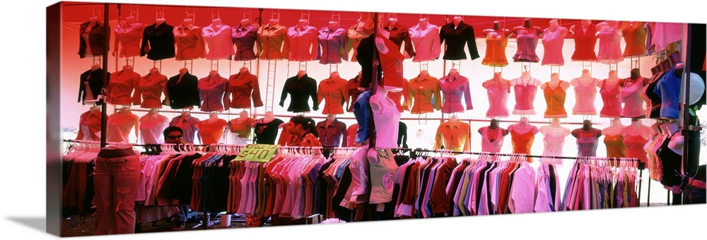 Large Gallery-Wrapped Canvas Wall Art Print 36 x 13 entitled Clothes hanging in a market stall, San Miguel De Allende, Gua... Gallery-Wrapped Canvas entitled Clothes hanging in a market stall, San Miguel De Allende, Guanajuato, Mexico.  Multiple sizes available.  Primary colors within this image include Dark Red, Dark Blue, Pink, Black.  Made in the USA.  Satisfaction guaranteed.  Inks used are latex-based and designed to last.  Canvas is acid-free and 20 millimeters thick.  Canvas frames are built with farmed or reclaimed domestic pine or poplar wood.