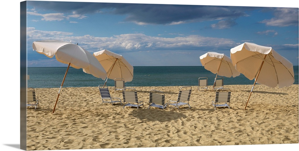 Large Gallery-Wrapped Canvas Wall Art Print 24 x 12 entitled Deck chairs and beach umbrellas on the beach, Jetties Beach, ... Gallery-Wrapped Canvas entitled Deck chairs and beach umbrellas on the beach, Jetties Beach, Nantucket, Massachusetts.  Landscape photograph of a heavily traveled beach on the New England coast with clouds gathering in the sky.  Multiple sizes available.  Primary colors within this image include Peach, Black, Gray Blue.  Made in the USA.  All products come with a 365 day workmanship guarantee.  Archival-quality UV-resistant inks.  Canvas is acid-free and 20 millimeters thick.  Museum-quality, artist-grade canvas mounted on sturdy wooden stretcher bars 1.5 thick.  Comes ready to hang.