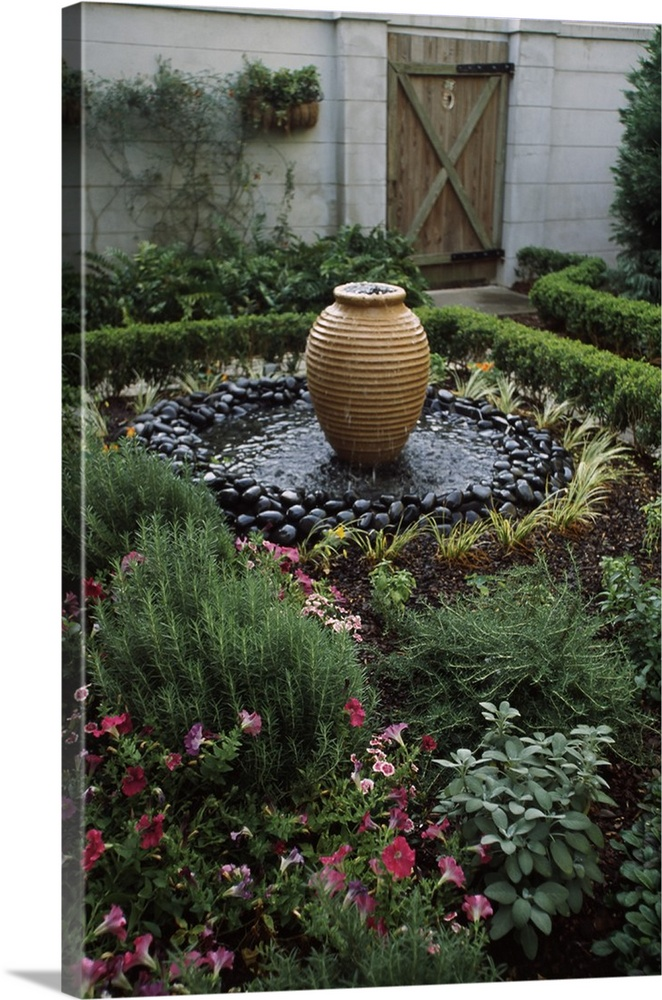 Large Solid-Faced Canvas Print Wall Art Print 20 x 30 entitled Decorative urn in a garden, Savannah, Chatham County, Georgia, Solid-Faced Canvas Print entitled Decorative urn in a garden, Savannah, Chatham County, Georgia,.  Multiple sizes available.  Primary colors within this image include Forest Green, Plum, Black, Light Gray.  Made in the USA.  Satisfaction guaranteed.  Archival-quality UV-resistant inks.  Canvas depth is 1.25 and includes a finished backing with pre-installed hanging hardware.  Canvas is handcrafted and made-to-order in the United States using high quality artist-grade canvas.