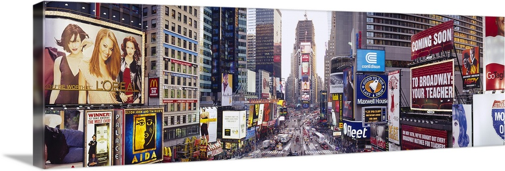 Large Solid-Faced Canvas Print Wall Art Print 48 x 16 entitled Dusk Times Square New York NY Solid-Faced Canvas Print entitled Dusk Times Square New York NY.  Panoramic photograph of a long angle street view of the Big Apple.  The busy street is filled with cars and lined with colorful skyscrapers and billboards.  Multiple sizes available.  Primary colors within this image include Plum, Light Yellow, Silver, Dark Forest Green.  Made in the USA.  All products come with a 365 day workmanship guarantee.  Archival-quality UV-resistant inks.  Featuring a proprietary design, our canvases produce the tightest corners without any bubbles, ripples, or bumps and will not warp or sag over time.  Archival inks prevent fading and preserve as much fine detail as possible with no over-saturation or color shifting.