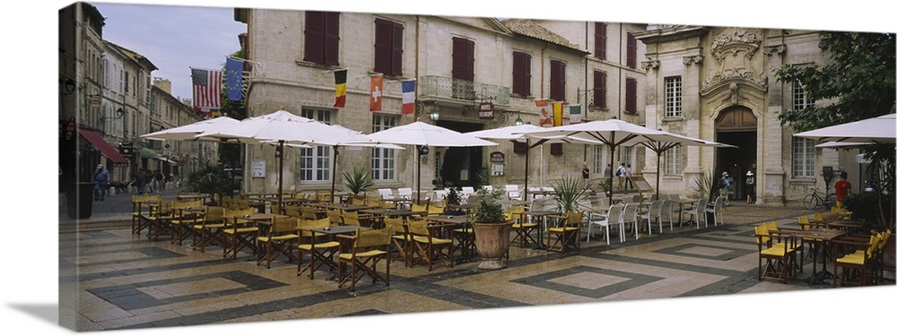 Large Gallery-Wrapped Canvas Wall Art Print 36 x 13 entitled Empty chairs and tables at a sidewalk cafe, Avignon, Vaucluse... Gallery-Wrapped Canvas entitled Empty chairs and tables at a sidewalk cafe, Avignon, Vaucluse, Provence-Alpes-Cote Dazur, France.  Multiple sizes available.  Primary colors within this image include Brown, Dark Gray, Light Gray.  Made in USA.  Satisfaction guaranteed.  Archival-quality UV-resistant inks.  Canvases are stretched across a 1.5 inch thick wooden frame with easy-to-mount hanging hardware.  Canvas is acid-free and 20 millimeters thick.