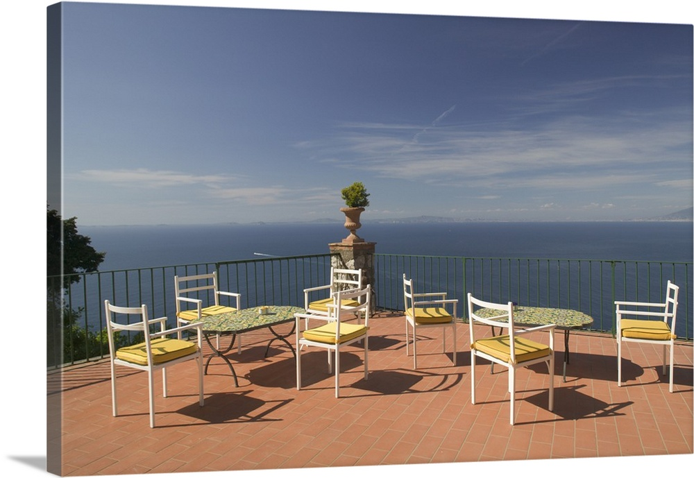 Large Solid-Faced Canvas Print Wall Art Print 30 x 20 entitled Empty tables and chairs on the balcony of a hotel, Ceasar A... Solid-Faced Canvas Print entitled Empty tables and chairs on the balcony of a hotel, Ceasar Augustus Hotel, Anacapri, Capri, Bay Of Naples, Campania, Italy.  Multiple sizes available.  Primary colors within this image include Brown, Peach, White, Gray Blue.  Made in USA.  Satisfaction guaranteed.  Inks used are latex-based and designed to last.  Archival inks prevent fading and preserve as much fine detail as possible with no over-saturation or color shifting.  Canvas depth is 1.25 and includes a finished backing with pre-installed hanging hardware.
