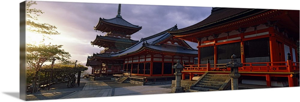 Large Solid-Faced Canvas Print Wall Art Print 48 x 16 entitled Facade of a temple, Kiyomizu-Dera Temple, Kyoto, Kyoto Pref... Solid-Faced Canvas Print entitled Facade of a temple, Kiyomizu-Dera Temple, Kyoto, Kyoto Prefecture, Kinki Region, Honshu, Japan.  Panoramic photograph on a giant canvas of the Kiyomizu-Dera Temple, shadowed as the sun sets in the sky, in the Kyoto Prefecture, Kinki Region, Honshu, Japan.  Multiple sizes available.  Primary colors within this image include Dark Red, Brown, Black, White.  Made in the USA.  Satisfaction guaranteed.  Inks used are latex-based and designed to last.  Archival inks prevent fading and preserve as much fine detail as possible with no over-saturation or color shifting.  Canvas depth is 1.25 and includes a finished backing with pre-installed hanging hardware.