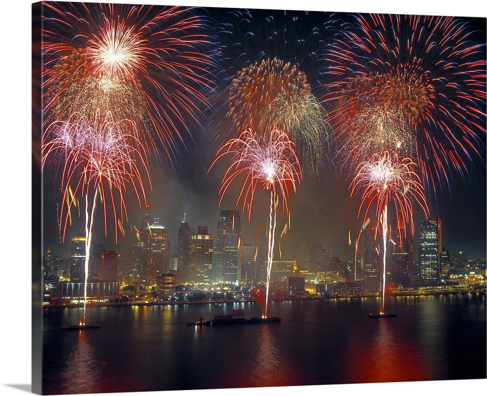 Large Solid-Faced Canvas Print Wall Art Print 45 x 36 entitled Fireworks display at night on Freedom Festival at Detroit v... Solid-Faced Canvas Print entitled Fireworks display at night on Freedom Festival at Detroit viewed, Ontario, Canada.  Multiple sizes available.  Primary colors within this image include Dark Red, Dark Gray, Silver.  Made in USA.  All products come with a 365 day workmanship guarantee.  Archival-quality UV-resistant inks.  Archival inks prevent fading and preserve as much fine detail as possible with no over-saturation or color shifting.  Featuring a proprietary design, our canvases produce the tightest corners without any bubbles, ripples, or bumps and will not warp or sag over time.