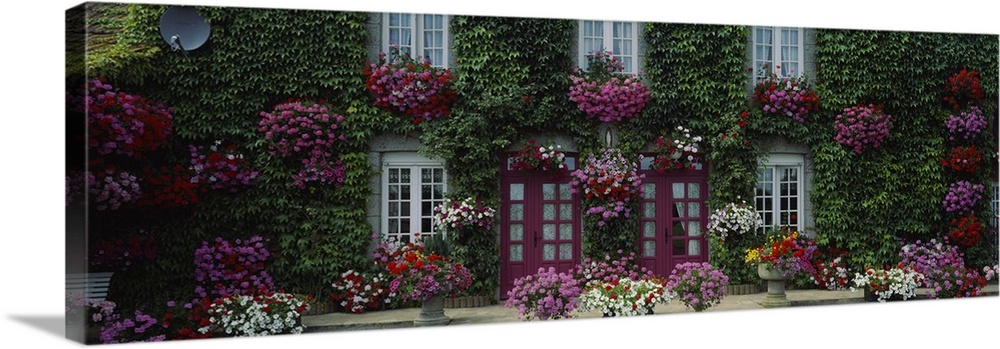 Large Solid-Faced Canvas Print Wall Art Print 48 x 16 entitled Flowers Breton Home Brittany France Solid-Faced Canvas Print entitled Flowers Breton Home Brittany France.  A French cottage garden home covered in flowers and greenery.  Multiple sizes available.  Primary colors within this image include Plum, Black, Gray, Silver.  Made in USA.  Satisfaction guaranteed.  Archival-quality UV-resistant inks.  Canvas depth is 1.25 and includes a finished backing with pre-installed hanging hardware.  Featuring a proprietary design, our canvases produce the tightest corners without any bubbles, ripples, or bumps and will not warp or sag over time.