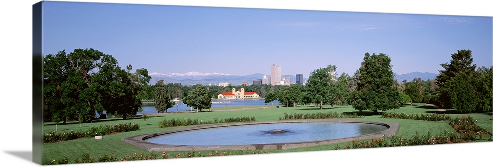 Large Solid-Faced Canvas Print Wall Art Print 48 x 16 entitled Formal garden in City Park with city and Mount Evans in bac... Solid-Faced Canvas Print entitled Formal garden in City Park with city and Mount Evans in background, Denver, Colorado.  Multiple sizes available.  Primary colors within this image include Sky Blue, Black, Silver, Dark Forest Green.  Made in the USA.  Satisfaction guaranteed.  Archival-quality UV-resistant inks.  Canvas depth is 1.25 and includes a finished backing with pre-installed hanging hardware.  Archival inks prevent fading and preserve as much fine detail as possible with no over-saturation or color shifting.