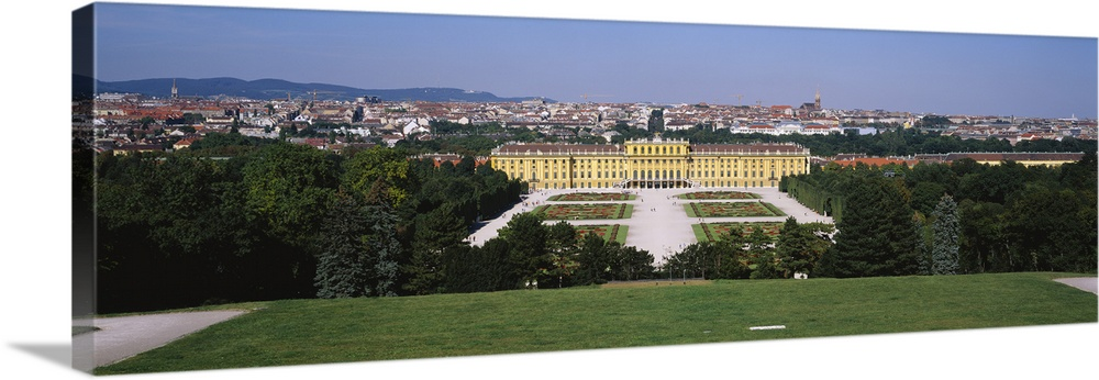 Large Solid-Faced Canvas Print Wall Art Print 48 x 16 entitled Formal garden in front of a palace, Schonbrunn Palace, Vien... Solid-Faced Canvas Print entitled Formal garden in front of a palace, Schonbrunn Palace, Vienna, Austria.  Multiple sizes available.  Primary colors within this image include Peach, Sky Blue, Black, Dark Forest Green.  Made in USA.  All products come with a 365 day workmanship guarantee.  Archival-quality UV-resistant inks.  Canvas is handcrafted and made-to-order in the United States using high quality artist-grade canvas.  Featuring a proprietary design, our canvases produce the tightest corners without any bubbles, ripples, or bumps and will not warp or sag over time.