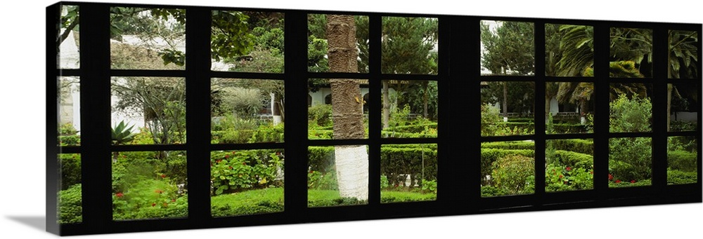 Large Solid-Faced Canvas Print Wall Art Print 48 x 16 entitled Formal garden viewed through a window, Hosteria La Cienega,... Solid-Faced Canvas Print entitled Formal garden viewed through a window, Hosteria La Cienega, Latacunga, Cotopaxi, Ecuador.  Panoramic image looking out of a silhouetted window into a garden.  Multiple sizes available.  Primary colors within this image include Dark Yellow, Black, Light Gray.  Made in the USA.  Satisfaction guaranteed.  Inks used are latex-based and designed to last.  Canvas is handcrafted and made-to-order in the United States using high quality artist-grade canvas.  Canvas depth is 1.25 and includes a finished backing with pre-installed hanging hardware.