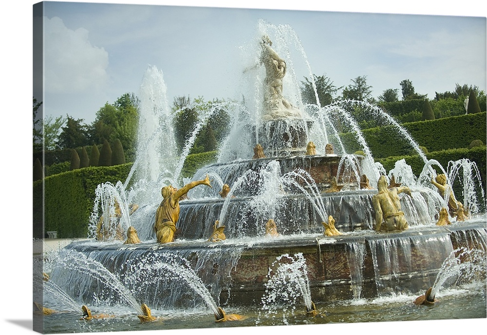 Large Solid-Faced Canvas Print Wall Art Print 30 x 20 entitled Fountain in a garden, Bassin De Latone, Versailles, Paris, ... Solid-Faced Canvas Print entitled Fountain in a garden, Bassin De Latone, Versailles, Paris, Ile de France, France.  Multiple sizes available.  Primary colors within this image include Dark Yellow, Silver, Dark Forest Green.  Made in USA.  Satisfaction guaranteed.  Archival-quality UV-resistant inks.  Featuring a proprietary design, our canvases produce the tightest corners without any bubbles, ripples, or bumps and will not warp or sag over time.  Canvas is handcrafted and made-to-order in the United States using high quality artist-grade canvas.
