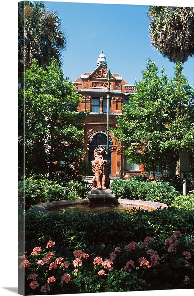 Large Solid-Faced Canvas Print Wall Art Print 20 x 30 entitled Fountain in a garden in front of a building, Savannah Cotto... Solid-Faced Canvas Print entitled Fountain in a garden in front of a building, Savannah Cotton Exchange, Savannah, Chatham County, Georgia,.  Multiple sizes available.  Primary colors within this image include Brown, Light Green, Sky Blue, Black.  Made in the USA.  Satisfaction guaranteed.  Inks used are latex-based and designed to last.  Featuring a proprietary design, our canvases produce the tightest corners without any bubbles, ripples, or bumps and will not warp or sag over time.  Canvas depth is 1.25 and includes a finished backing with pre-installed hanging hardware.