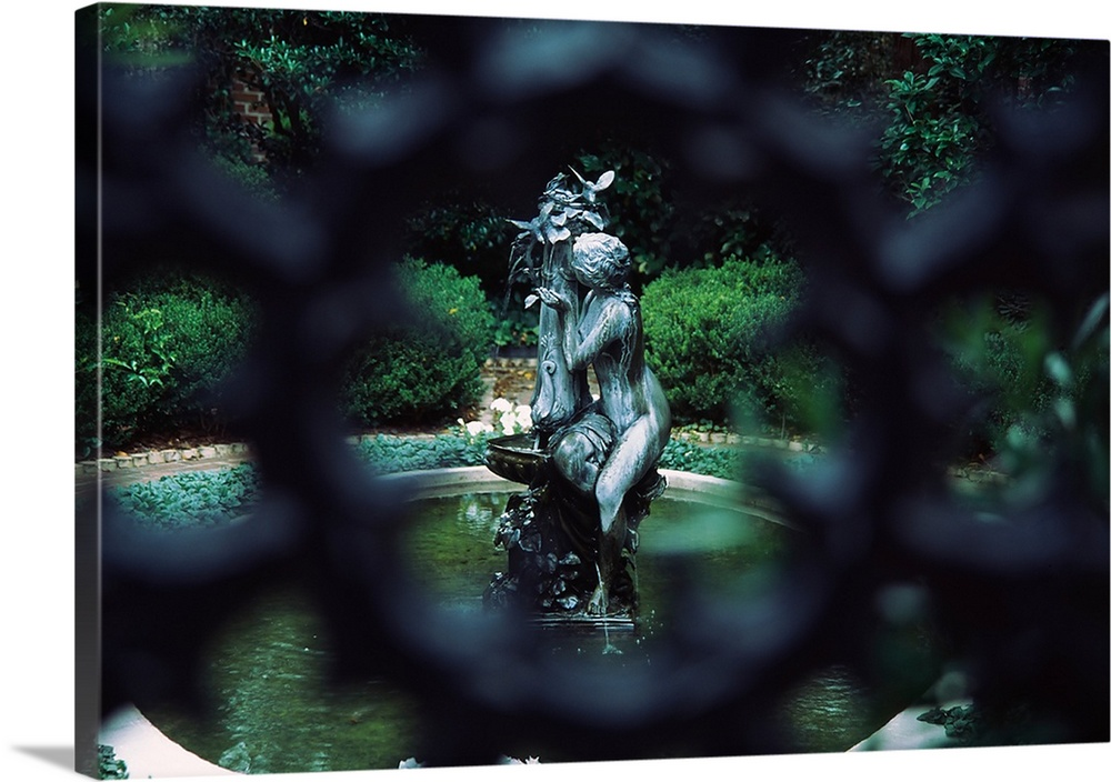 Large Solid-Faced Canvas Print Wall Art Print 30 x 20 entitled Fountain in a garden, Savannah, Chatham County, Georgia, Solid-Faced Canvas Print entitled Fountain in a garden, Savannah, Chatham County, Georgia,.  Multiple sizes available.  Primary colors within this image include Forest Green, White, Dark Forest Green.  Made in the USA.  All products come with a 365 day workmanship guarantee.  Inks used are latex-based and designed to last.  Canvas depth is 1.25 and includes a finished backing with pre-installed hanging hardware.  Featuring a proprietary design, our canvases produce the tightest corners without any bubbles, ripples, or bumps and will not warp or sag over time.