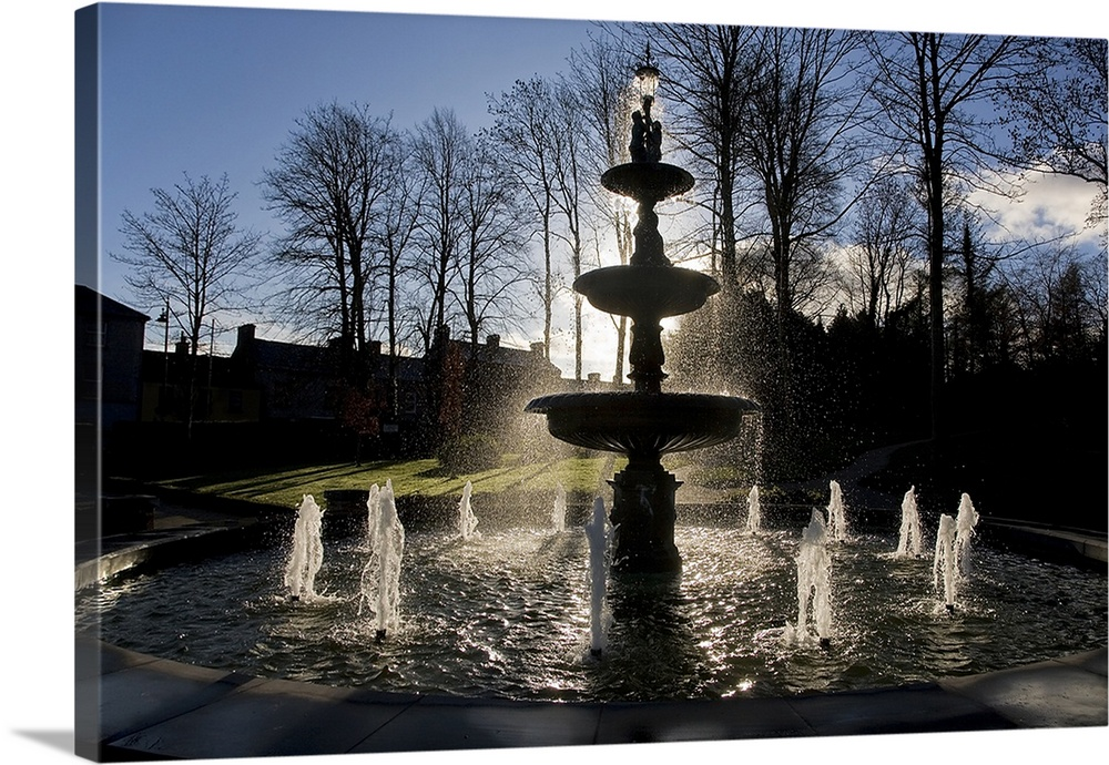 Large Solid-Faced Canvas Print Wall Art Print 30 x 20 entitled Fountain in the Millennium Garden, Lismore, County Waterfor... Solid-Faced Canvas Print entitled Fountain in the Millennium Garden, Lismore, County Waterford, Ireland.  Multiple sizes available.  Primary colors within this image include Black, Silver, Dark Forest Green, Gray Blue.  Made in the USA.  Satisfaction guaranteed.  Inks used are latex-based and designed to last.  Canvas depth is 1.25 and includes a finished backing with pre-installed hanging hardware.  Archival inks prevent fading and preserve as much fine detail as possible with no over-saturation or color shifting.