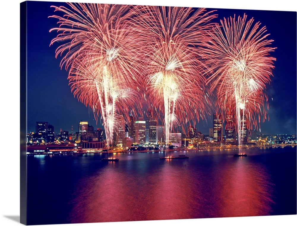 Large Solid-Faced Canvas Print Wall Art Print 48 x 36 entitled Freedom Fest Fireworks at night, Detroit, Wayne County, Mic... Solid-Faced Canvas Print entitled Freedom Fest Fireworks at night, Detroit, Wayne County, Michigan.  Freedom Fest Fireworks at night, Detroit, Wayne County, Michigan, USA.  Multiple sizes available.  Primary colors within this image include Dark Blue, Pink, Peach, White.  Made in the USA.  All products come with a 365 day workmanship guarantee.  Archival-quality UV-resistant inks.  Featuring a proprietary design, our canvases produce the tightest corners without any bubbles, ripples, or bumps and will not warp or sag over time.  Canvas depth is 1.25 and includes a finished backing with pre-installed hanging hardware.
