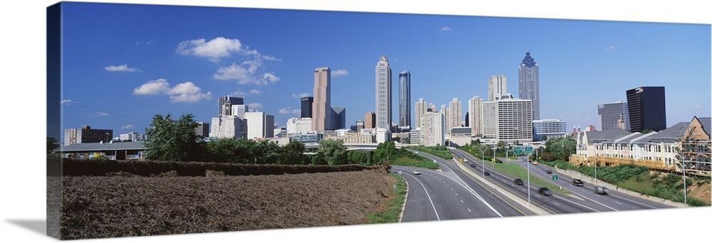 Large Solid-Faced Canvas Print Wall Art Print 60 x 20 entitled Freedom Parkway & skyline Atlanta GA Solid-Faced Canvas Print entitled Freedom Parkway  skyline Atlanta GA.  Multiple sizes available.  Primary colors within this image include Black, Gray, Silver, Royal Blue.  Made in the USA.  All products come with a 365 day workmanship guarantee.  Inks used are latex-based and designed to last.  Archival inks prevent fading and preserve as much fine detail as possible with no over-saturation or color shifting.  Canvas is handcrafted and made-to-order in the United States using high quality artist-grade canvas.