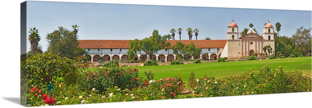 Large Solid-Faced Canvas Print Wall Art Print 48 x 16 entitled Garden in front of a mission Mission Santa Barbara Santa Ba... Solid-Faced Canvas Print entitled Garden in front of a mission Mission Santa Barbara Santa Barbara Santa Barbara County California.  Multiple sizes available.  Primary colors within this image include Red, Forest Green, Silver, Lime Green.  Made in the USA.  Satisfaction guaranteed.  Archival-quality UV-resistant inks.  Canvas is handcrafted and made-to-order in the United States using high quality artist-grade canvas.  Featuring a proprietary design, our canvases produce the tightest corners without any bubbles, ripples, or bumps and will not warp or sag over time.
