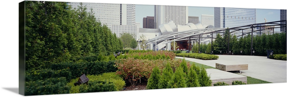 Large Solid-Faced Canvas Print Wall Art Print 48 x 16 entitled Garden in front of buildings, Millennium Park, Chicago, Ill... Solid-Faced Canvas Print entitled Garden in front of buildings, Millennium Park, Chicago, Illinois.  Multiple sizes available.  Primary colors within this image include Forest Green, Black, Silver.  Made in the USA.  Satisfaction guaranteed.  Inks used are latex-based and designed to last.  Featuring a proprietary design, our canvases produce the tightest corners without any bubbles, ripples, or bumps and will not warp or sag over time.  Canvas depth is 1.25 and includes a finished backing with pre-installed hanging hardware.