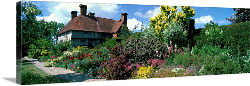 Large Solid-Faced Canvas Print Wall Art Print 48 x 16 entitled Great Dixter Gardens East Sussex England Solid-Faced Canvas Print entitled Great Dixter Gardens East Sussex England.  Multiple sizes available.  Primary colors within this image include Light Yellow, Sky Blue, Black, White.  Made in USA.  All products come with a 365 day workmanship guarantee.  Archival-quality UV-resistant inks.  Canvas depth is 1.25 and includes a finished backing with pre-installed hanging hardware.  Archival inks prevent fading and preserve as much fine detail as possible with no over-saturation or color shifting.