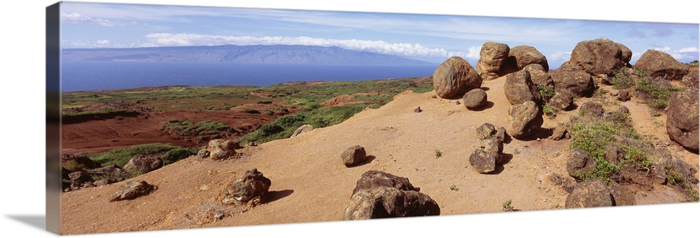 Large Solid-Faced Canvas Print Wall Art Print 48 x 16 entitled Hawaii, Lanai, Garden of the Gods, Rock formation and uncul... Solid-Faced Canvas Print entitled Hawaii, Lanai, Garden of the Gods, Rock formation and uncultivated plant on the mountain.  Multiple sizes available.  Primary colors within this image include Brown, Peach, Black, Pale Blue.  Made in the USA.  Satisfaction guaranteed.  Inks used are latex-based and designed to last.  Canvas is handcrafted and made-to-order in the United States using high quality artist-grade canvas.  Featuring a proprietary design, our canvases produce the tightest corners without any bubbles, ripples, or bumps and will not warp or sag over time.