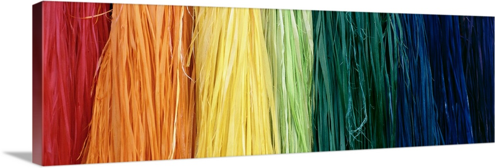 Large Gallery-Wrapped Canvas Wall Art Print 36 x 13 entitled Hawaiian Grass Skirts Gallery-Wrapped Canvas entitled Hawaiian Grass Skirts.  Multiple sizes available.  Primary colors within this image include Orange Dark Red Light Yellow Black.  Made in USA.  Satisfaction guaranteed.  Inks used are latex-based and designed to last.  Canvas frames are built with farmed or reclaimed domestic pine or poplar wood.  Canvas is designed to prevent fading.