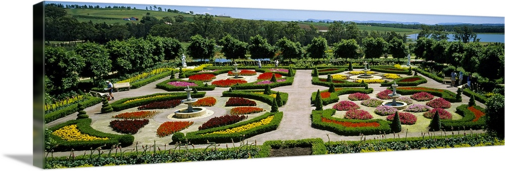 Large Solid-Faced Canvas Print Wall Art Print 48 x 16 entitled High angle view of a botanical garden,Hunter Valley gardens... Solid-Faced Canvas Print entitled High angle view of a botanical garden,Hunter Valley gardens, NSW, Australia.  Multiple sizes available.  Primary colors within this image include Dark Yellow, Black, Pale Blue.  Made in USA.  All products come with a 365 day workmanship guarantee.  Inks used are latex-based and designed to last.  Canvas is handcrafted and made-to-order in the United States using high quality artist-grade canvas.  Archival inks prevent fading and preserve as much fine detail as possible with no over-saturation or color shifting.