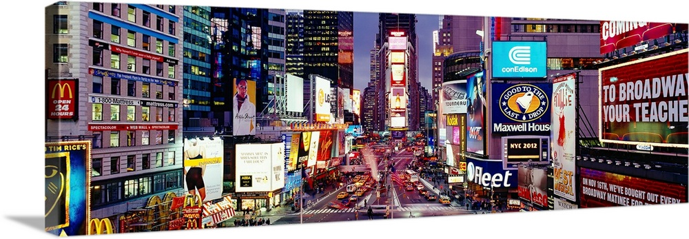 Large Solid-Faced Canvas Print Wall Art Print 48 x 16 entitled High angle view of traffic on a road, Times Square, Manhatt... Solid-Faced Canvas Print entitled High angle view of traffic on a road, Times Square, Manhattan, New York City, New York State.  Panoramic photograph of neon signs and city streets downtown.  Multiple sizes available.  Primary colors within this image include Dark Red, Dark Blue, Black, White.  Made in USA.  Satisfaction guaranteed.  Archival-quality UV-resistant inks.  Archival inks prevent fading and preserve as much fine detail as possible with no over-saturation or color shifting.  Canvas is handcrafted and made-to-order in the United States using high quality artist-grade canvas.