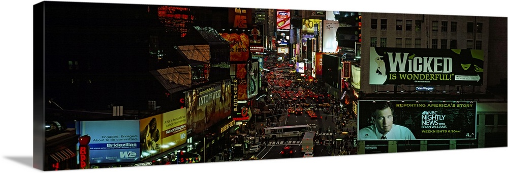 Large Solid-Faced Canvas Print Wall Art Print 48 x 16 entitled High angle view of traffic on the road, Times Square, Manha... Solid-Faced Canvas Print entitled High angle view of traffic on the road, Times Square, Manhattan, New York City, New York State.  Multiple sizes available.  Primary colors within this image include Dark Red, Dark Yellow, Pink, Black.  Made in the USA.  All products come with a 365 day workmanship guarantee.  Inks used are latex-based and designed to last.  Archival inks prevent fading and preserve as much fine detail as possible with no over-saturation or color shifting.  Canvas depth is 1.25 and includes a finished backing with pre-installed hanging hardware.