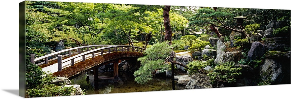 Large Solid-Faced Canvas Print Wall Art Print 48 x 16 entitled Imperial Palace Gardens Kyoto Japan Solid-Faced Canvas Print entitled Imperial Palace Gardens Kyoto Japan.  Panoramic photo on canvas of a bridge leading over a river with a garden on the right.  Multiple sizes available.  Primary colors within this image include Brown, Dark Yellow, Black, White.  Made in USA.  Satisfaction guaranteed.  Inks used are latex-based and designed to last.  Canvas depth is 1.25 and includes a finished backing with pre-installed hanging hardware.  Featuring a proprietary design, our canvases produce the tightest corners without any bubbles, ripples, or bumps and will not warp or sag over time.