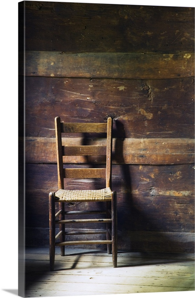 Large Solid-Faced Canvas Print Wall Art Print 20 x 30 entitled Ladderback chair in empty room, Mountain Farm Museum, Great... Solid-Faced Canvas Print entitled Ladderback chair in empty room, Mountain Farm Museum, Great Smoky Mountains National Park, North Carolina.  Portrait photo of an empty ladderback wooden chair sitting in a beat up wood slat wall room with sanded down floors.  Multiple sizes available.  Primary colors within this image include Peach, Dark Gray, White.  Made in USA.  Satisfaction guaranteed.  Inks used are latex-based and designed to last.  Featuring a proprietary design, our canvases produce the tightest corners without any bubbles, ripples, or bumps and will not warp or sag over time.  Canvas depth is 1.25 and includes a finished backing with pre-installed hanging hardware.