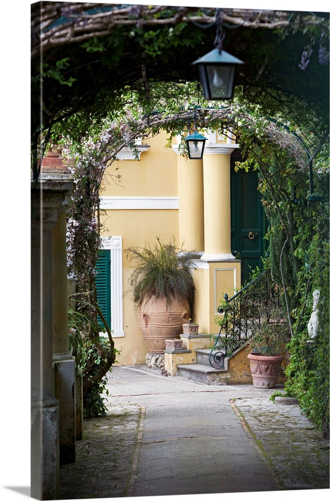 Large Solid-Faced Canvas Print Wall Art Print 20 x 30 entitled Lanterns hanging in a garden, Capri, Naples, Campania, Italy Solid-Faced Canvas Print entitled Lanterns hanging in a garden, Capri, Naples, Campania, Italy.  A vertical photograph or a walkway under vine covered arches in a scenic Italian city.  Multiple sizes available.  Primary colors within this image include Forest Green, Black, Gray, White.  Made in USA.  Satisfaction guaranteed.  Archival-quality UV-resistant inks.  Canvas is handcrafted and made-to-order in the United States using high quality artist-grade canvas.  Canvas depth is 1.25 and includes a finished backing with pre-installed hanging hardware.