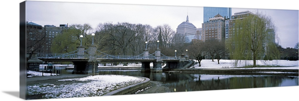 Large Solid-Faced Canvas Print Wall Art Print 48 x 16 entitled Last snow of the season, Boston Public Garden, Boston, Suff... Solid-Faced Canvas Print entitled Last snow of the season, Boston Public Garden, Boston, Suffolk County, Massachusetts.  Panoramic photo print of a snowy portion of Boston near a waterfront.  Multiple sizes available.  Primary colors within this image include Gray, White.  Made in USA.  All products come with a 365 day workmanship guarantee.  Archival-quality UV-resistant inks.  Archival inks prevent fading and preserve as much fine detail as possible with no over-saturation or color shifting.  Canvas depth is 1.25 and includes a finished backing with pre-installed hanging hardware.