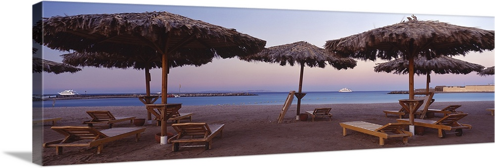 Large Solid-Faced Canvas Print Wall Art Print 48 x 16 entitled Lounge chairs with sunshades on the beach, Hilton Resort, H... Solid-Faced Canvas Print entitled Lounge chairs with sunshades on the beach, Hilton Resort, Hurghada, Egypt.  Multiple sizes available.  Primary colors within this image include Brown, Dark Gray, White.  Made in the USA.  All products come with a 365 day workmanship guarantee.  Inks used are latex-based and designed to last.  Featuring a proprietary design, our canvases produce the tightest corners without any bubbles, ripples, or bumps and will not warp or sag over time.  Archival inks prevent fading and preserve as much fine detail as possible with no over-saturation or color shifting.