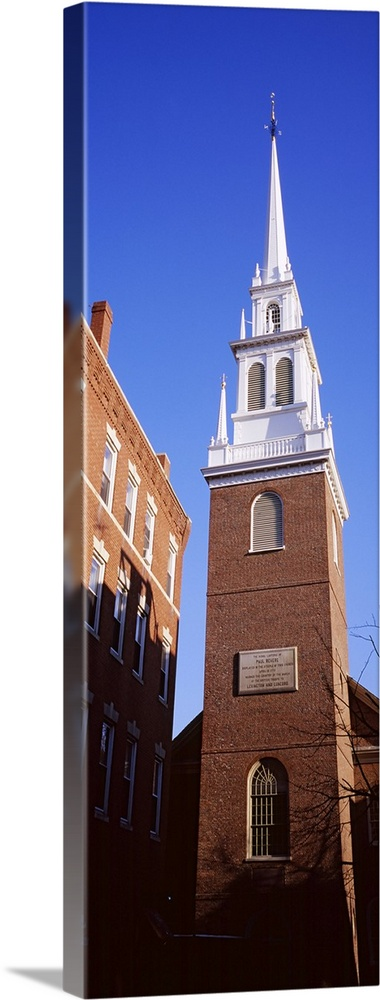 Large Solid-Faced Canvas Print Wall Art Print 20 x 60 entitled Low angle view of a church, Old North Church, Freedom Trail... Solid-Faced Canvas Print entitled Low angle view of a church, Old North Church, Freedom Trail, Boston, Massachusetts.  Multiple sizes available.  Primary colors within this image include Peach, Black, White, Royal Blue.  Made in USA.  All products come with a 365 day workmanship guarantee.  Inks used are latex-based and designed to last.  Archival inks prevent fading and preserve as much fine detail as possible with no over-saturation or color shifting.  Canvas depth is 1.25 and includes a finished backing with pre-installed hanging hardware.