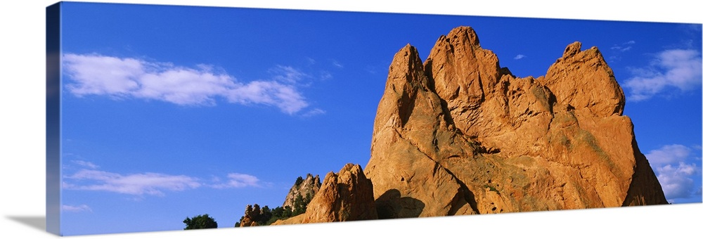 Large Solid-Faced Canvas Print Wall Art Print 48 x 16 entitled Low angle view of a cliff, Garden of the Gods, Colorado Spr... Solid-Faced Canvas Print entitled Low angle view of a cliff, Garden of the Gods, Colorado Springs, Colorado.  Multiple sizes available.  Primary colors within this image include Brown, Peach, Black, Royal Blue.  Made in the USA.  All products come with a 365 day workmanship guarantee.  Inks used are latex-based and designed to last.  Archival inks prevent fading and preserve as much fine detail as possible with no over-saturation or color shifting.  Featuring a proprietary design, our canvases produce the tightest corners without any bubbles, ripples, or bumps and will not warp or sag over time.