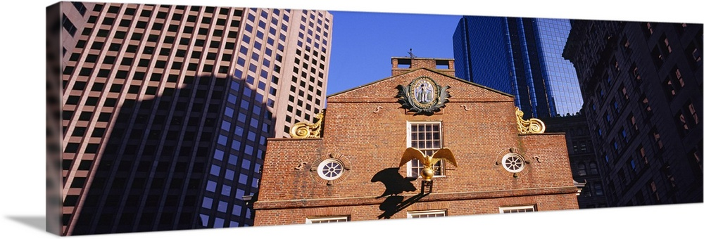 Large Solid-Faced Canvas Print Wall Art Print 60 x 20 entitled Low angle view of a golden eagle outside of a building, Old... Solid-Faced Canvas Print entitled Low angle view of a golden eagle outside of a building, Old State House, Freedom Trail, Boston, Massachusetts.  Multiple sizes available.  Primary colors within this image include Dark Blue, Black, White, Royal Blue.  Made in the USA.  All products come with a 365 day workmanship guarantee.  Archival-quality UV-resistant inks.  Canvas is handcrafted and made-to-order in the United States using high quality artist-grade canvas.  Archival inks prevent fading and preserve as much fine detail as possible with no over-saturation or color shifting.