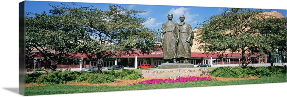 Large Solid-Faced Canvas Print Wall Art Print 48 x 16 entitled Low angle view of Mayo brothers statue in a garden, Civic C... Solid-Faced Canvas Print entitled Low angle view of Mayo brothers statue in a garden, Civic Center Gardens, Rochester, Minnesota.  Multiple sizes available.  Primary colors within this image include Fuschia, Sky Blue, Black, White.  Made in the USA.  Satisfaction guaranteed.  Inks used are latex-based and designed to last.  Featuring a proprietary design, our canvases produce the tightest corners without any bubbles, ripples, or bumps and will not warp or sag over time.  Canvas depth is 1.25 and includes a finished backing with pre-installed hanging hardware.