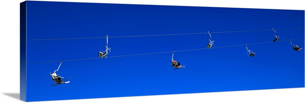 Large Gallery-Wrapped Canvas Wall Art Print 30 x 10 entitled Low angle view of ski lifts, Stuben, Austria Gallery-Wrapped Canvas entitled Low angle view of ski lifts, Stuben, Austria.  Low angle view of a chair lift, Ski area of Stuben, Austria.  Multiple sizes available.  Primary colors within this image include Dark Blue, Black.  Made in USA.  Satisfaction guaranteed.  Archival-quality UV-resistant inks.  Canvases have a UVB protection built in to protect against fading and moisture and are designed to last for over 100 years.  Canvases are stretched across a 1.5 inch thick wooden frame with easy-to-mount hanging hardware.