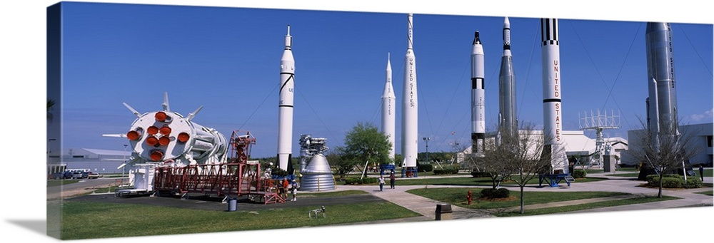 Large Solid-Faced Canvas Print Wall Art Print 48 x 16 entitled Missiles and rockets in a museum Rocket Garden NASA Kennedy... Solid-Faced Canvas Print entitled Missiles and rockets in a museum Rocket Garden NASA Kennedy Space Center Merritt Island Brevard County Florida.  Multiple sizes available.  Primary colors within this image include Black, Silver, Dark Forest Green, Royal Blue.  Made in the USA.  Satisfaction guaranteed.  Inks used are latex-based and designed to last.  Archival inks prevent fading and preserve as much fine detail as possible with no over-saturation or color shifting.  Canvas is handcrafted and made-to-order in the United States using high quality artist-grade canvas.