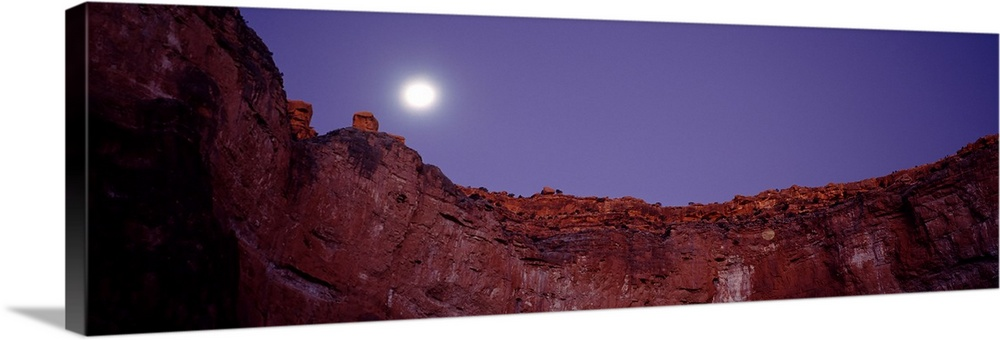 Large Solid-Faced Canvas Print Wall Art Print 48 x 16 entitled Moon and stars over a canyon, Grand Canyon, Indian Garden C... Solid-Faced Canvas Print entitled Moon and stars over a canyon, Grand Canyon, Indian Garden Campground, Grand Canyon National Park, Arizona,.  Multiple sizes available.  Primary colors within this image include Dark Red, Gray, White, Muted Blue.  Made in USA.  Satisfaction guaranteed.  Archival-quality UV-resistant inks.  Canvas is handcrafted and made-to-order in the United States using high quality artist-grade canvas.  Canvas depth is 1.25 and includes a finished backing with pre-installed hanging hardware.