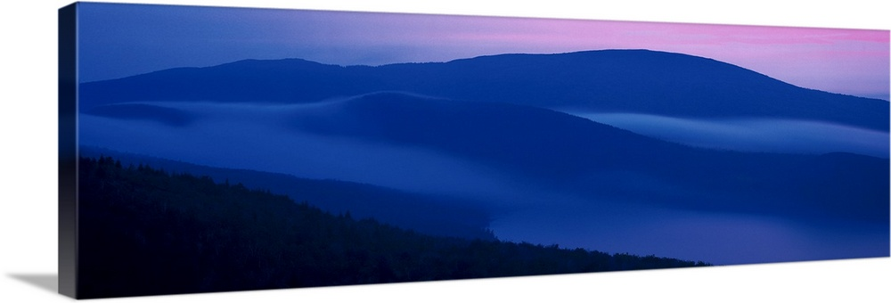 Large Solid-Faced Canvas Print Wall Art Print 48 x 16 entitled Mountains Acadia National Park ME Solid-Faced Canvas Print entitled Mountains Acadia National Park ME.  Panoramic photograph on a big wall hanging of shadowed mountains at sunset at Acadia National Park, in Maine.  Multiple sizes available.  Primary colors within this image include Dark Blue, Sky Blue, Black.  Made in the USA.  All products come with a 365 day workmanship guarantee.  Inks used are latex-based and designed to last.  Archival inks prevent fading and preserve as much fine detail as possible with no over-saturation or color shifting.  Canvas depth is 1.25 and includes a finished backing with pre-installed hanging hardware.