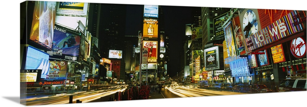 Large Solid-Faced Canvas Print Wall Art Print 48 x 16 entitled Neon boards in a city lit up at night, Times Square, New Yo... Solid-Faced Canvas Print entitled Neon boards in a city lit up at night, Times Square, New York City, New York State.  Wide angle photograph of Times Square in New York City, brightly lit at night.  Multiple sizes available.  Primary colors within this image include Orange, Dark Red, Black, Pale Blue.  Made in USA.  All products come with a 365 day workmanship guarantee.  Inks used are latex-based and designed to last.  Archival inks prevent fading and preserve as much fine detail as possible with no over-saturation or color shifting.  Canvas depth is 1.25 and includes a finished backing with pre-installed hanging hardware.