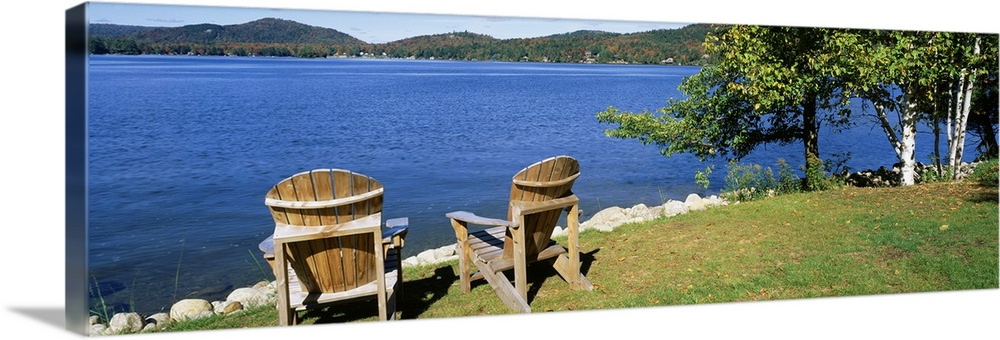 Large Gallery-Wrapped Canvas Wall Art Print 30 x 10 entitled New York, Adirondack State Park, Adirondack Mountains, Fourth... Gallery-Wrapped Canvas entitled New York, Adirondack State Park, Adirondack Mountains, Fourth Lake, Adirondack Chairs on a lawn.  Multiple sizes available.  Primary colors within this image include Dark Forest Green, Pale Blue, Royal Blue, Dark Navy Blue.  Made in USA.  Satisfaction guaranteed.  Inks used are latex-based and designed to last.  Canvases have a UVB protection built in to protect against fading and moisture and are designed to last for over 100 years.  Canvas is acid-free and 20 millimeters thick.