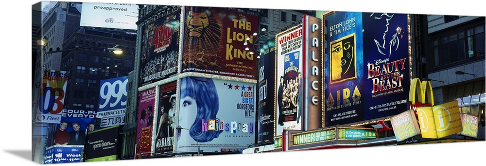 Large Solid-Faced Canvas Print Wall Art Print 48 x 16 entitled New York State, New York City, Times Square, Billboards on ... Solid-Faced Canvas Print entitled New York State, New York City, Times Square, Billboards on buildings in a city.  Multiple sizes available.  Primary colors within this image include Dark Red, Dark Yellow, Light Yellow, Black.  Made in USA.  All products come with a 365 day workmanship guarantee.  Inks used are latex-based and designed to last.  Featuring a proprietary design, our canvases produce the tightest corners without any bubbles, ripples, or bumps and will not warp or sag over time.  Canvas is handcrafted and made-to-order in the United States using high quality artist-grade canvas.