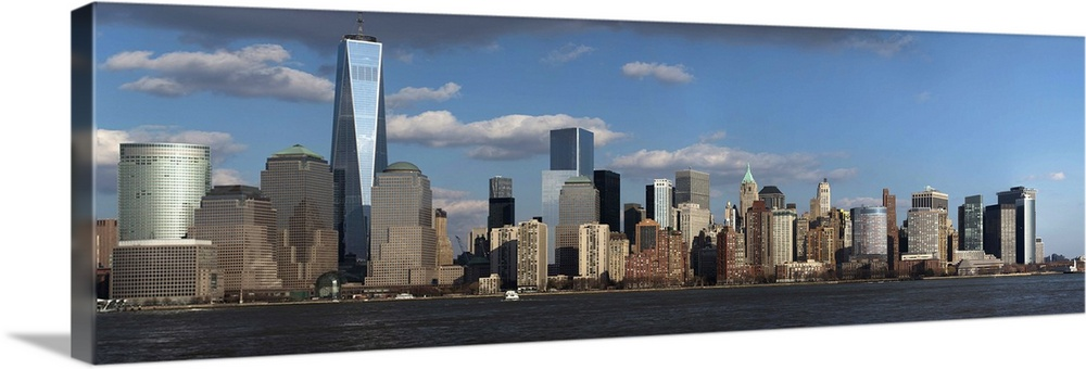 Large Solid-Faced Canvas Print Wall Art Print 60 x 20 entitled NYC Skyline on water featuring One World Trade Center Solid-Faced Canvas Print entitled NYC Skyline on water featuring One World Trade Center.  Panoramic view of New York City Skyline on water featuring One World Trade Center 1WTC, Freedom Tower, New York City, New York, USA City, New York, USA.  Multiple sizes available.  Primary colors within this image include Dark Gray, White, Gray Blue.  Made in the USA.  All products come with a 365 day workmanship guarantee.  Archival-quality UV-resistant inks.  Canvas depth is 1.25 and includes a finished backing with pre-installed hanging hardware.  Featuring a proprietary design, our canvases produce the tightest corners without any bubbles, ripples, or bumps and will not warp or sag over time.