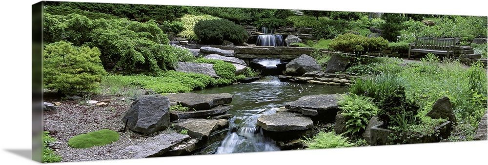 Large Solid-Faced Canvas Print Wall Art Print 48 x 16 entitled Ohio, Columbus, Inniswood Metro Gardens, River flowing thro... Solid-Faced Canvas Print entitled Ohio, Columbus, Inniswood Metro Gardens, River flowing through a forest.  Multiple sizes available.  Primary colors within this image include Forest Green, Light Green, Black, Light Gray.  Made in the USA.  All products come with a 365 day workmanship guarantee.  Inks used are latex-based and designed to last.  Featuring a proprietary design, our canvases produce the tightest corners without any bubbles, ripples, or bumps and will not warp or sag over time.  Canvas depth is 1.25 and includes a finished backing with pre-installed hanging hardware.