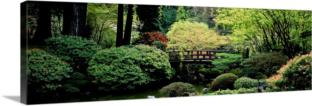Large Solid-Faced Canvas Print Wall Art Print 48 x 16 entitled Panoramic view of a garden, Japanese Garden, Washington Par... Solid-Faced Canvas Print entitled Panoramic view of a garden, Japanese Garden, Washington Park, Portland, Oregon.  Multiple sizes available.  Primary colors within this image include Forest Green, Light Yellow, Black, Gray.  Made in USA.  All products come with a 365 day workmanship guarantee.  Archival-quality UV-resistant inks.  Featuring a proprietary design, our canvases produce the tightest corners without any bubbles, ripples, or bumps and will not warp or sag over time.  Canvas depth is 1.25 and includes a finished backing with pre-installed hanging hardware.