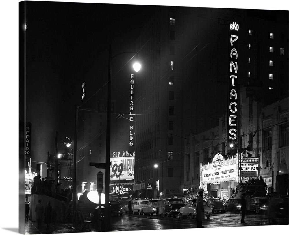 Large Gallery-Wrapped Canvas Wall Art Print 24 x 19 entitled Pantages Theater Academy Awards Ceremony First Televised Broa... Gallery-Wrapped Canvas entitled Pantages Theater Academy Awards Ceremony First Televised Broadcast.  1950s 1953 Pantages Theater Academy Awards Ceremony First Televised Broadcast Los Angeles California USA.  Multiple sizes available.  Primary colors within this image include Black, Light Gray, White.  Made in the USA.  All products come with a 365 day workmanship guarantee.  Inks used are latex-based and designed to last.  Canvases are stretched across a 1.5 inch thick wooden frame with easy-to-mount hanging hardware.  Canvas is a 65 polyester, 35 cotton base, with two acrylic latex primer basecoats and a semi-gloss inkjet receptive topcoat.